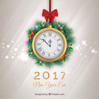 Fondo bokeh de año nuevo con un reloj dorado