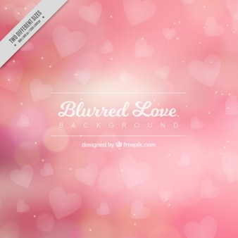 Fondo borroso de amor con corazones rosas