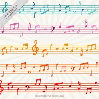 Fondo colorido con notas musicales y pentagramas