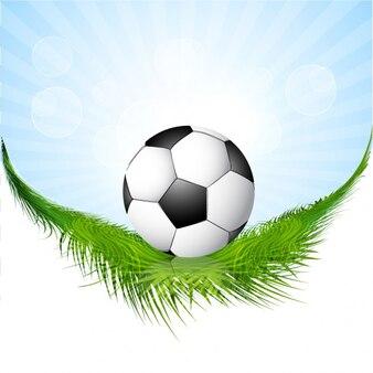 Fondo con el balón de fútbol sobre césped