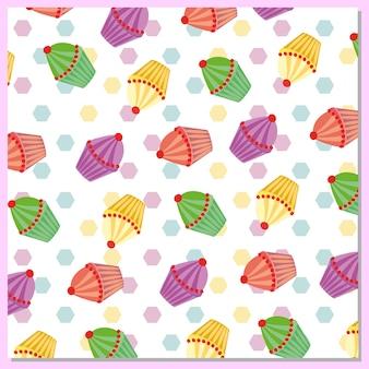Fondo con patrón de cupcakes multicolor