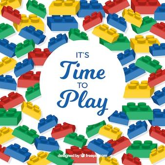 Fondo con piezas de plástico y frase  es tiempo de jugar