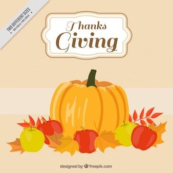 Fondo de acción de gracias con una enorme calabaza y algunas manzanas