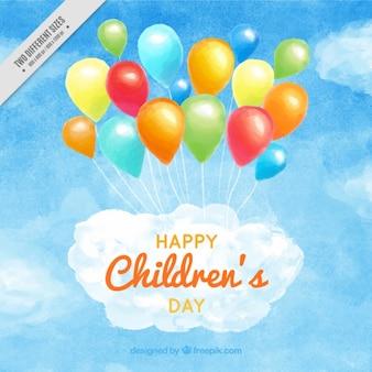 Fondo de acuarela de feliz día del niño con globos de colores