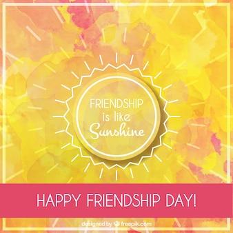 Fondo de acuarela del día de la amistad con un sol