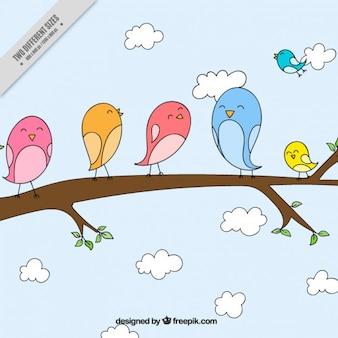 Fondo de adorables pájaros dibujados a mano en una rama