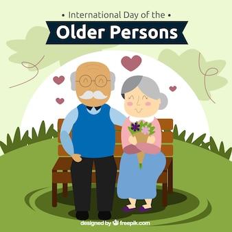 Fondo de amorosa pareja mayor en un banco