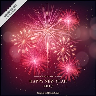 Fondo de año nuevo 2017 brillantes fuegos artificiales