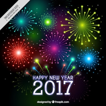 Fondo de año nuevo 2017 de fuegos artificiales de colores