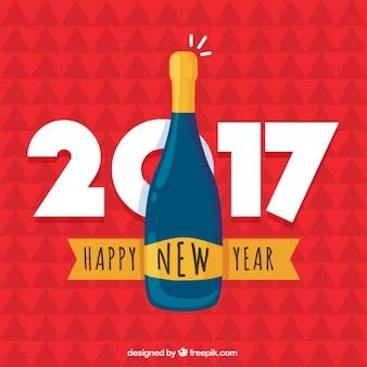 Fondo de año nuevo con una botella de champán