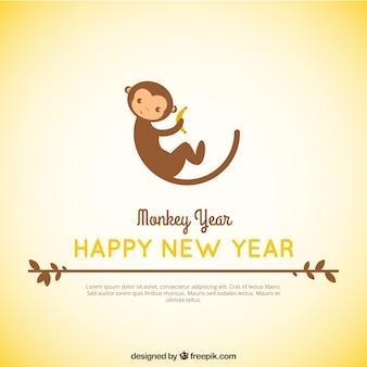 Fondo de año nuevo de mono adorable comiendo un plátano