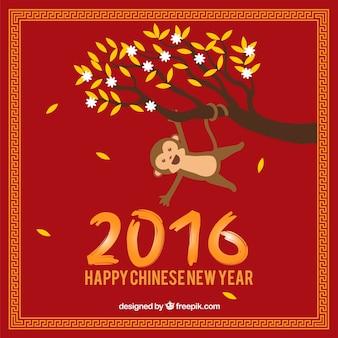 Fondo de año nuevo de mono colgando de una rama
