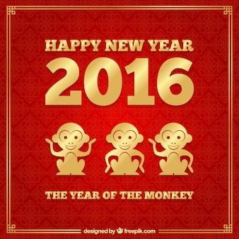 Fondo de año nuevo del mono en color rojo y dorado