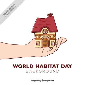 Fondo de boceto de mano sosteniendo una casa