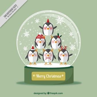 Fondo de bola de nieve con pingüinos