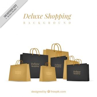 Fondo de bolsas lujosas negras y doradas