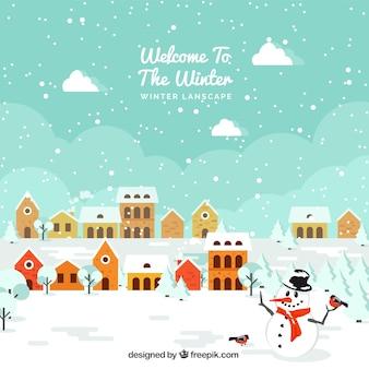 Fondo de bonito paisaje de casas nevadas con muñeco de nieve