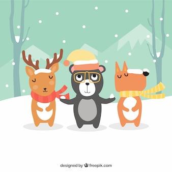 Fondo de bonitos animales con gorro y bufanda en un paisaje de invierno