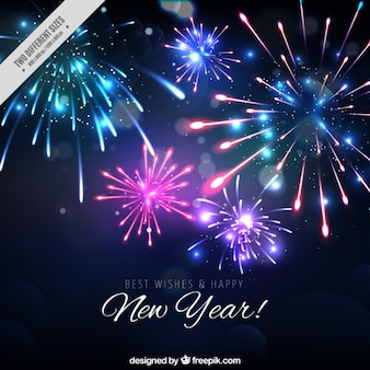 Fondo de brillantes fuegos artificiales de año nuevo