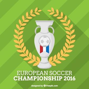 Fondo de campo de fútbol con un trofeo plateado y corona de laurel