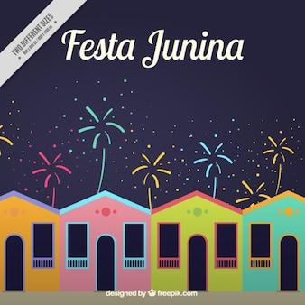 Fondo de casas de colores con fuegos artificiales