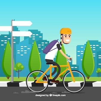 Fondo de ciclista por la ciudad en diseño plano