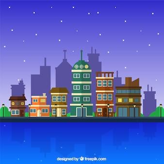 Fondo de ciudad de noche con edificios en diseño plano