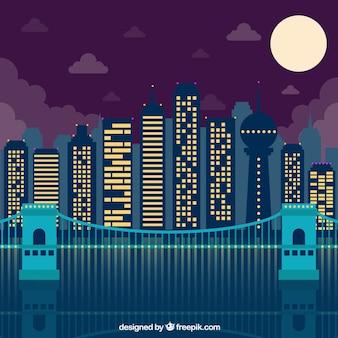 Fondo de ciudad moderna con edificios iluminados de noche