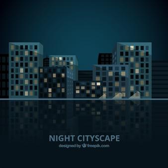 Fondo de ciudad nocturna con edificios