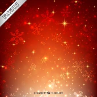 Fondo de copos de nieve brillantes en tonos cálidos