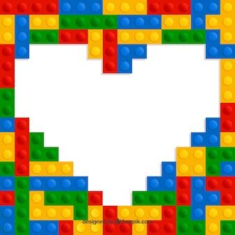 Fondo de corazón y piezas de plástico