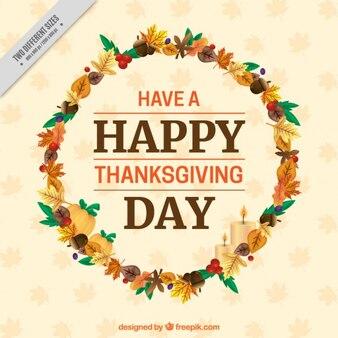 Fondo de corona de hojas secas con un mensaje de felicitación de acción de gracias