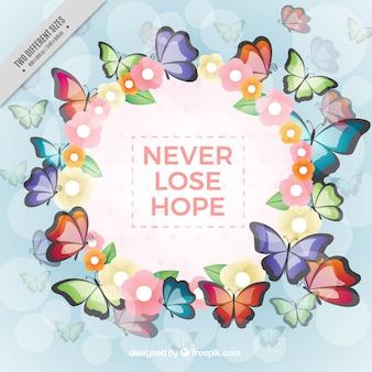 Fondo de corona floral con mariposas e inspiradora frase