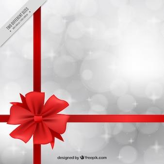 Fondo de cumpleaños brillante con cinta roja y efecto bokeh