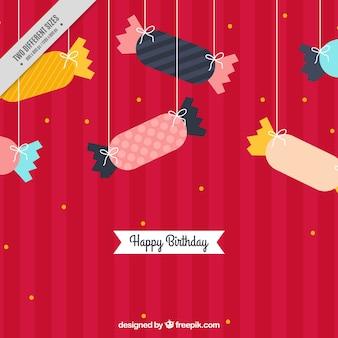 Fondo de cumpleaños rayado con caramelos colgando