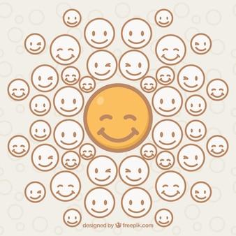 Fondo de emoticono amarillo sonriente rodeado de emotioconos