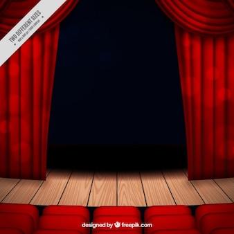 Fondo de escenario de teatro con cortinas y asientos