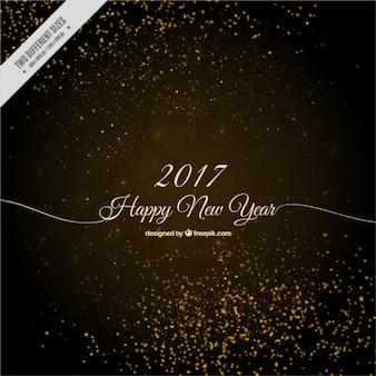 Fondo de feliz año nuevo con destellos dorados