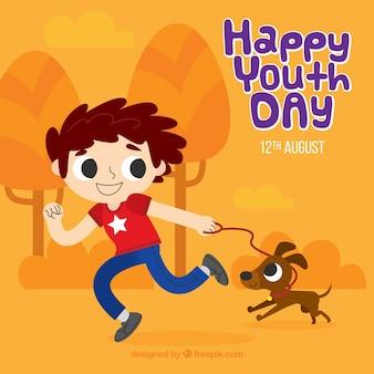 Fondo de feliz día de la juventud con chico jugando con su perro