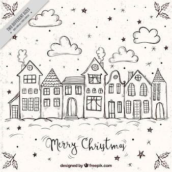 Fondo de feliz navidad con bocetos de casas