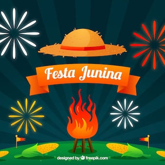 Fondo de festa junina con fuegos artificiales y hoguera