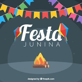 Fondo de festa junina con hoguera y guirnaldas de colores en diseño plano