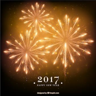 Fondo de fuegos artificiales dorados de año nuevo