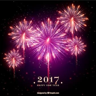 Fondo de fuegos artificiales rosas de año nuevo