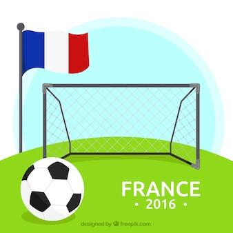 Fondo de fútbol con una portería y una bandera de francia