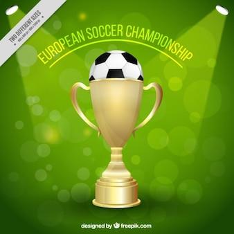 Fondo de fútbol de trofeo dorado con una pelota