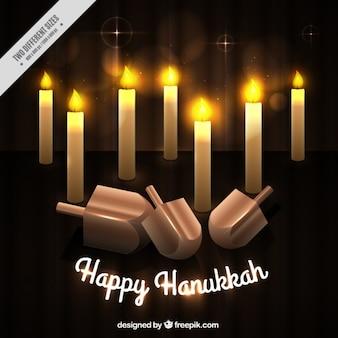 Fondo de hanukkah con velas encendidas y peonzas
