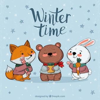Fondo de invierno con animales lindos