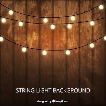 Fondo de madera con bombillas decorativas