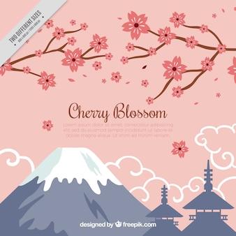 Fondo de montañas y ramas con flores de cerezo
